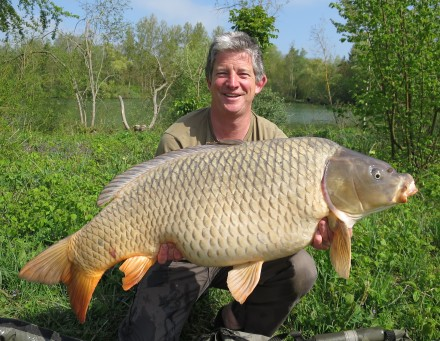 Alex with a 50lb Common Carp from the Elf Lake Les Quis