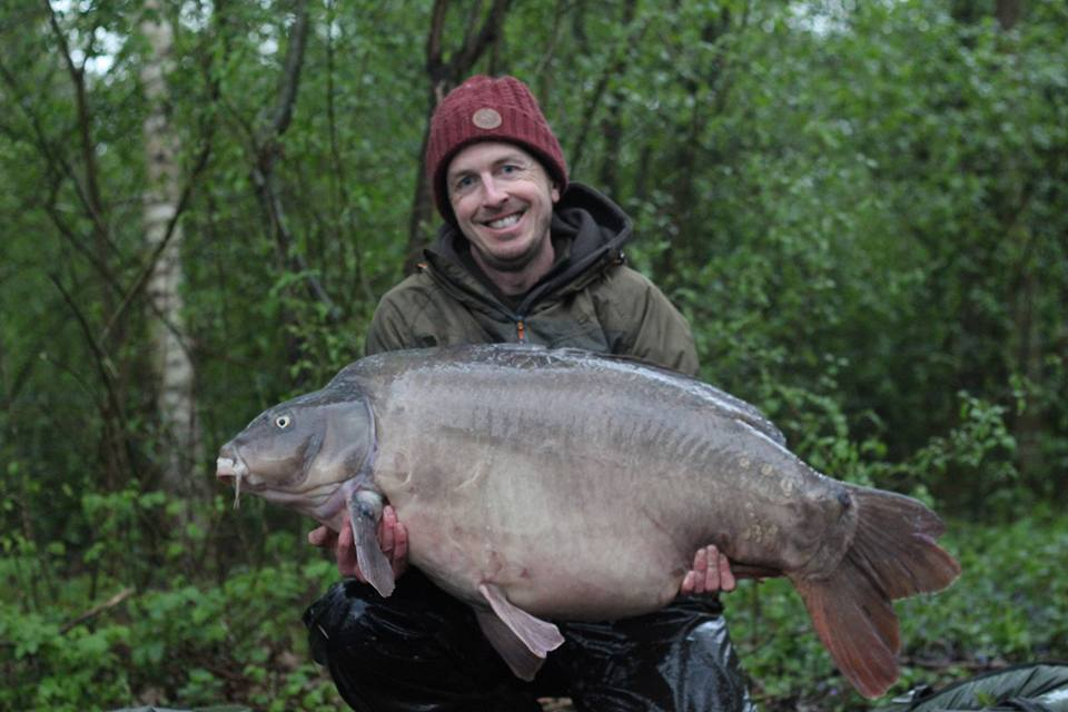 Wesley Penn with a 60lb 4oz Mirror Old Lake Les Quis